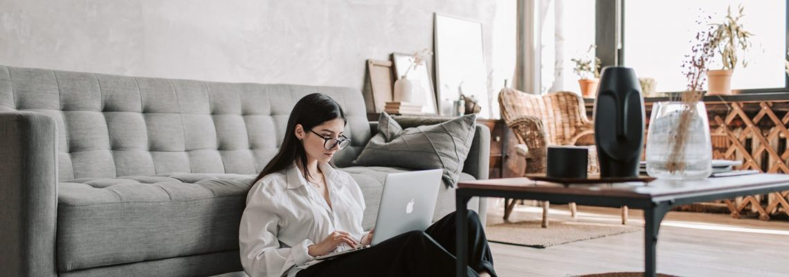 woman-sitting-on-the-floor-while-using-her-laptop-4050292